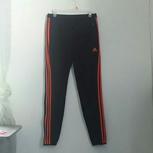 Red-striped Adidas running pants